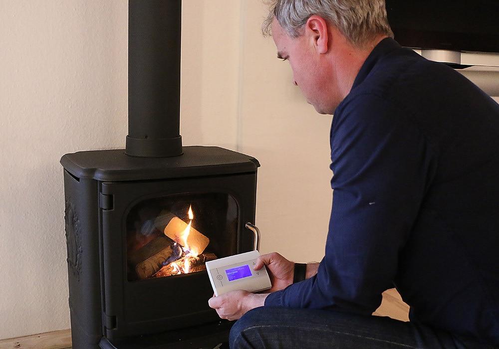 john damsted lighting the fireplace